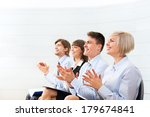 Small photo of Successful business people group applauding after presentation, businesspeople applause sitting in row at the meeting office room on conference