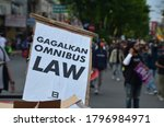 Small photo of Yogyakarta, Indonesia - August 14, 2020: GEJAYAN MEMANGGIL, demonstrations conducted by students on Jalan Affandi (Gejayan) aim to reject the ratification of OMNIBUS law and racial violence.