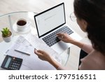 Small photo of Close up top view of concentrated woman work on laptop manage family expenditures expenses using gadget, focused housewife busy calculating finances, plan budget on computer, pay bills or taxes online