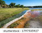 Hot springs mineral water flows through Hot Springs State Park in Thermopolis, Wyoming