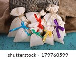 sacks on color wooden table  on ... | Shutterstock . vector #179760599