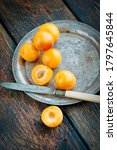 Small photo of Yellow mirabelle plums in rustic metal dish