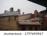 Wet Tile Roofs And Chimneys Of...