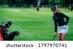Young Female Golfer Preparing...