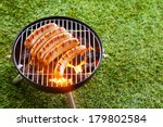 sausages grilling over the hot... | Shutterstock . vector #179802584