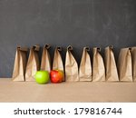 Stock photo a row of brown bags against a blackboard 179816744