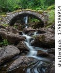 A Packhorse Bridge Crossing A...