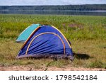 A Tent Set Up In A Rugged...