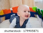cute baby plays in a baby cot | Shutterstock . vector #179905871