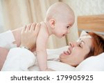 the happy woman with the baby... | Shutterstock . vector #179905925