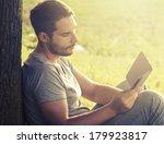 young man reading e book under... | Shutterstock . vector #179923817