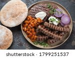 round beige tray with grilled...