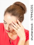 a portrait of young woman suffering a headache or pain  - stock photo