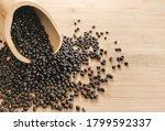 black lentils isolated.dry... | Shutterstock . vector #1799592337