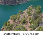 The gorgeous red rook walled Green River flowing through the Flaming Gorge  National Recreation Area in Ashley National Forest, Utah