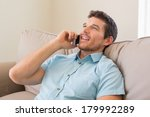 relaxed smiling young man using ... | Shutterstock . vector #179992289