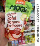 Small photo of Viersen, Germany - July 9. 2020: Closeup of bag demeter children drink fruits hold by hand in german supermarket (focus on center of bag)