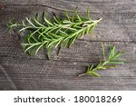 rosemary on old wood table | Shutterstock . vector #180018269