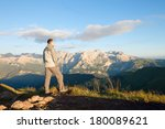 man on the top of the mountains.... | Shutterstock . vector #180089621