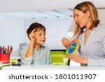 Small photo of Boy with autism spectrum disorder learn clock and hours, teacher during ABA therapy class