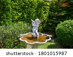 Cupid Statue Decorated In The...
