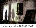 Small photo of Mysterious shadow of a woman in an abandoned house - Silhouette of female ghost standing on the door of the room - Fear concept in abandoned house - Halloween concept