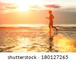 silhouette of woman jogger at... | Shutterstock . vector #180127265