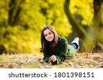 Smiling Teenage Girl Lying On...