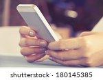 woman using a smart phone | Shutterstock . vector #180145385
