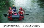 Group Of People On Raft Boat...