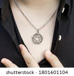Pentagram pendant on the chest...
