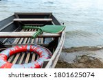 A Lifeboat Moored Near A Wooden ...
