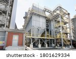 Small photo of Industrial dust collector air bag filter in the plant. It is a system used to enhance the quality of air released from industrial and commercial processes by collecting dust.