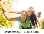 beautiful couple having fun... | Shutterstock . vector #180164381