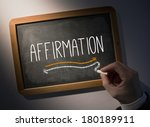 Small photo of Hand writing the word affirmation on black chalkboard