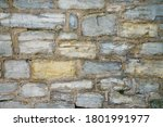 A Fragment Of A Stone Wall Mad...