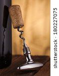 corkscrew and wine bottle   | Shutterstock . vector #180227075