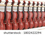 Rows Of Vintage Red Wooden...