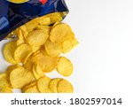 Small photo of one of the types of snacks, fast food, junk food - ruffled potato chips spilling out of an open bag on a white background