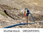 Small photo of Dewatering construction site. Pumping water out of the construction site. Construction dewatering and groundwater pumping. Submersible pump dewater construction site.