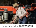 Old Farmer Working On Red...