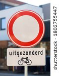 Small photo of Nijverdal, Overijssel/The Netherlands - August 2, 2020: Dutch traffic sign signifying closed in both directions with with exception of bicycle riders. TRANSLATION: 'EXCEPT'