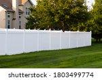 White vinyl fence outdoor...