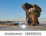 welder working with electrode... | Shutterstock . vector #180350231