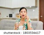Happy Woman Taking Vitamin Pill ...