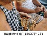 Two Old Females Weaving Basket...