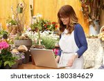 small flower shop owner working ... | Shutterstock . vector #180384629