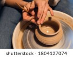A Master In A Pottery Workshop...