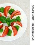 fresh tasty caprese salad | Shutterstock . vector #180453407
