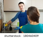 smiling plumber repairing a... | Shutterstock . vector #180460409
